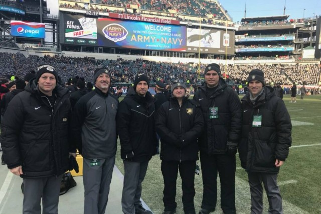 Maj. David Tennent, John A. Feagin, Jr. Orthopaedic Sports Medicine Fellow (sixth from l-r) poses with some of the Army West Point Football medical staff prior to kickoff of the 2018 Army-Navy Football game at Lincoln Financial Field, Philadelphia, Penn. Pictured is (from l-r) Col. Chad Haley, Chief, Dept. of Surgery; Dr. David Ness, Sports Chiropractor; Dr. Brian Colsant, Primary Care Sports Medicine; Lt. Col. Matthew Posner, Orthopaedic Surgeon and Director of the John A. Feagin, Jr. Orthopaedic Sports Medicine Fellowship; and Maj. Michael Donohue and Tennent, both John A. Feagin, Jr. Orthopaedic Sports Medicine Fellow.