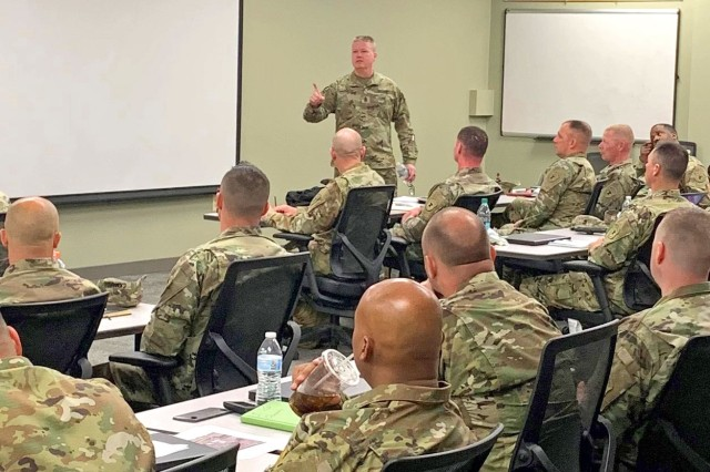 Tank-automotive and Armaments Command's Command Sgt. Major Ian Griffin talks with Soldiers from the 3rd Recruiting Battalion during a 1st Sgt. training session. The Soldiers are at the Detroit Arsenal as part of their annual recruiters training.