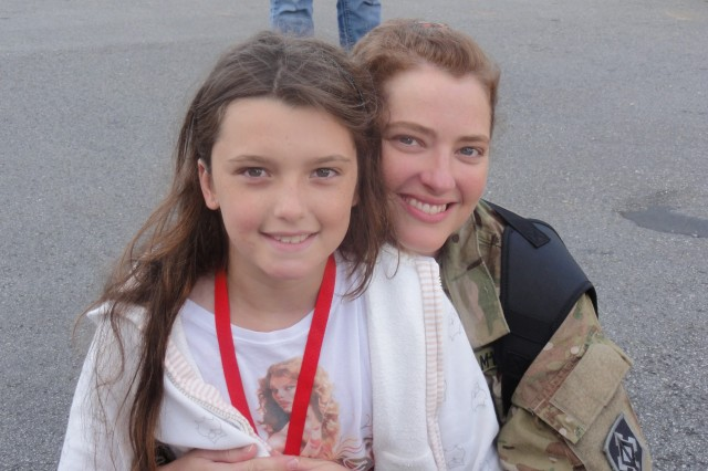 Eight-year-old Elizabeth McCallum-Polleys enjoys a happy moment with her mom, now-Maj. Tara McCallum before McCallum's deployment to Afghanistan.