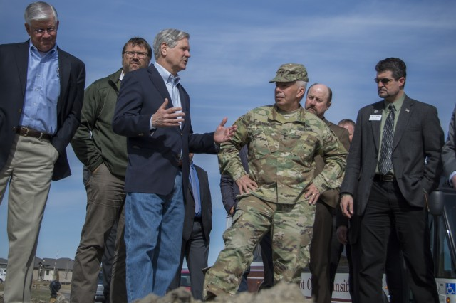 The U.S. Army Corps of Engineers Chief of Engineers and Commanding General Lt. Gen. Todd T. Semonite gets a first-hand look at the Mouse River Enhanced Flood Protection Plan, a local project in Minot, North Dakota, developed after the 2011 flood that went into construction in 2018. The tour, with Sen. John Hoeven, Col. Sam Calkins, St. Paul District commander, city of Minot officials, the Souris River Joint Water Resource Board and representatives from various federal agencies, took place after Semonite signed the Chief's Report progressing a flood risk management project here that would fill the gaps between phases of the Mouse River plan.