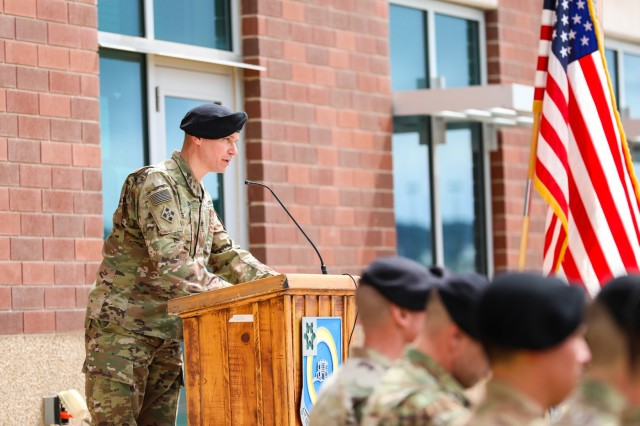 Col. Dave Zinn, 2nd Infantry Brigade Combat Team, 4th Infantry Division commander, speaks during an award ceremony, April 12, 2019, on Fort Carson, Colo. Four Soldiers were presented with valor awards for their heroic actions on October of 2018 in Helmand Province, Afghanistan by Zinn during the ceremony.