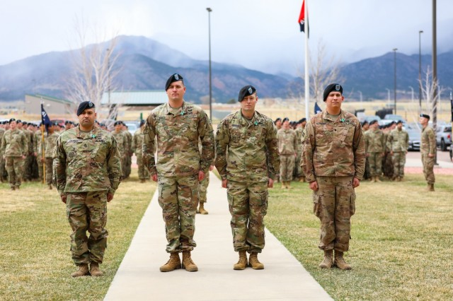 Sgt. 1st Class Timoeto Salinas, Staff Sgt. Ryan Bomze, Staff Sgt. Andrew Brant and Spc. Alexander Jimenez, assigned to 1st Battalion, 41st Infantry Regiment, 2nd Infantry Brigade Combat Team, 4th Infantry Division, stand in front of their leaders and peers, April 12, 2019, during an awards ceremony on Fort Carson, Colo.