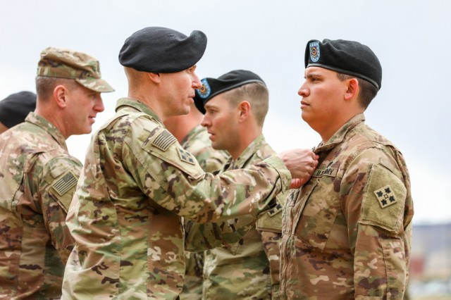 Col. Dave Zinn, 2nd Infantry Brigade Combat Team, 4th Infantry Division commander, pins an Army Commendation Medal with a V device on Spc. Alexander Jimenez, assigned to 1st Battalion, 41st Infantry Regiment, 2IBCT, April 12, 2019, during an awards ceremony on Fort Carson, Colo. Jimenez and three other Soldiers earned valor awards for their heroic on October of 2018 in Helmand Province, Afghanistan by Zinn during the ceremony.