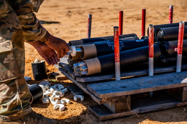 FORT BENNING, Ga. - A member of a mortar crew removes a round during the live-fire exercise of the 2019 Best Mortar Competition April 11 at Red Cloud Range here. After three days of competition among 19 U.S. Army mortar teams and one Dutch army mortar team, the 82nd Airborne Division prevailed as champions during the Best Mortar Competition April 11 here. The winning team was from the 1st Battalion, 505th Parachute Infantry Regiment, 82nd Airborne Division, from Fort Bragg, NC. The squad included Staff Sgt. James Pennington, Sgt. Alec Norton, Spc. Christian Elliot and Pfc. Loren Dow. The 82nd Airborne Division also won during the first year of the competition, when Pennington and Norton were on the team.