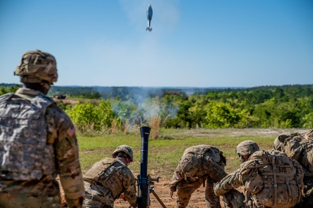A mortar crew fires off a round as part of the Best Mortar Competition live-fire exercise April 11 at Red Cloud Range here. After three days of competition among 19 U.S. Army mortar teams and one Dutch army mortar team, the 82nd Airborne Division prevailed as champions during the Best Mortar Competition April 11 here. The winning team was from the 1st Battalion, 505th Parachute Infantry Regiment, 82nd Airborne Division, from Fort Bragg, NC. The squad included Staff Sgt. James Pennington, Sgt. Alec Norton, Spc. Christian Elliot and Pfc. Loren Dow. The 82nd Airborne Division also won during the first year of the competition, when Pennington and Norton were on the team.