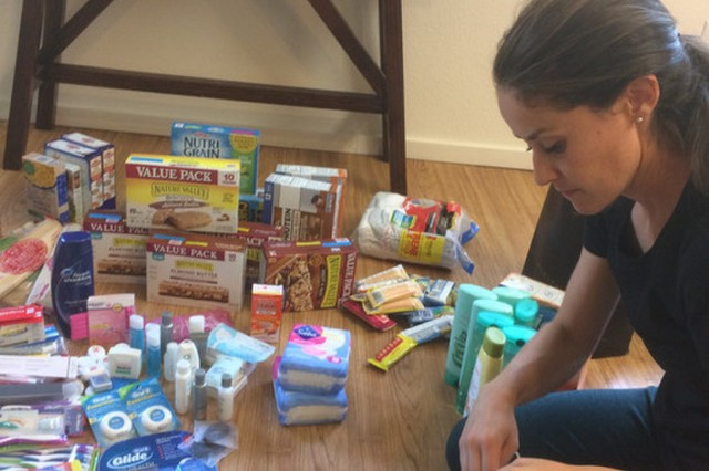 Ava Simmons at home sorting through the donations in preparation for drop-off to the food pantry on April 10, 2019 in Honolulu, Hawaii.