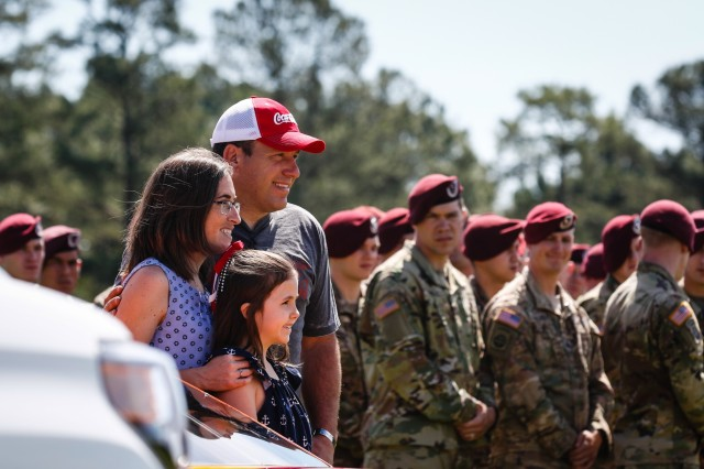 Ryan Newman, left, NASCAR driver, and the Gold Star Family of fallen Soldier, Sgt. James Nolen, who was killed in action during his 2009 deployment to Afghanistan, pose for a photo after NASCAR unveiled a race car with Nolen's name stenciled across the windshield during a military appreciation day event at Fort Bragg, N.C., April 17, 2019. The military appreciation day event was in part an opportunity for NASCAR professionals to learn more about the capabilities of the U.S. Army. (U.S. Army photo by Pfc. Hubert D. Delany III/ 22nd Mobile Public Affairs Detachment)