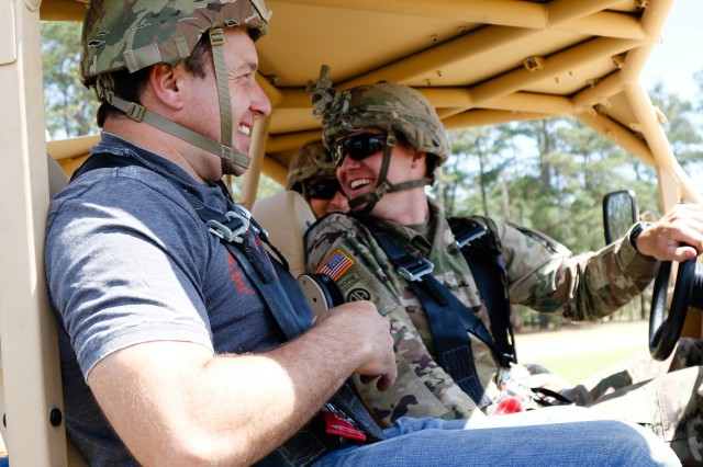 Ryan Newman, left, NASCAR driver, prepares for a ride-along with paratroopers of 2nd Brigade Combat Team, 82nd Airborne Division, during a military appreciation day event at Fort Bragg, N.C., April 17, 2019. The event was an opportunity for NASCAR professionals to learn more about the capabilities of the U.S. Army. (U.S. Army photo by Pfc. Hubert D. Delany III/ 22nd Mobile Public Affairs Detachment)