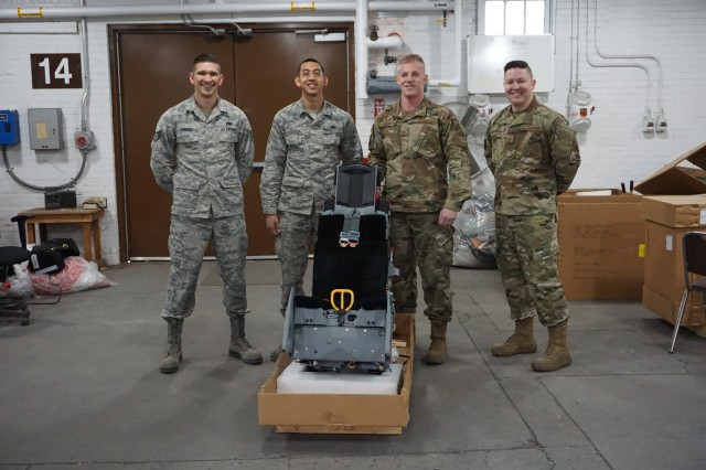 A U.S. Air Force Egress team made up of members of the 56th Component and Maintenance Squadron, Luke Air Force Base, Arizona, and 49th Component Squadron, Holloman Air Force Base, New Mexico prepared approximately 25 Advanced Concept Ejection Seats for USAF reutilization while at Letterkenny Munitions Center. Pictured left to right:  Staff Sergeant Benjamin Roberds, 49th CMS, Senior Airman Raboni Ferrer, 49th CMS, Senior Airman Cody Vanoosten, 56th CMS, and Staff Sergeant Brian Leach, 56th CMS.