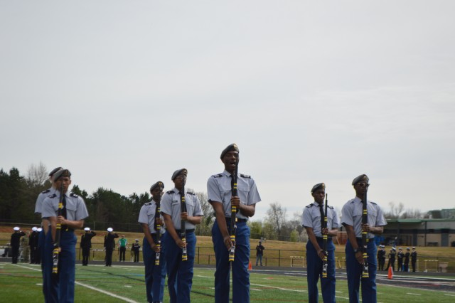 Nicholas Bostick, front, and other members of Blythewood High School's Junior Reserve Officers' Training Corps team run through drills. Bostick plans to complete Basic Combat Training this summer as a rising senior through the Split Training Option program.