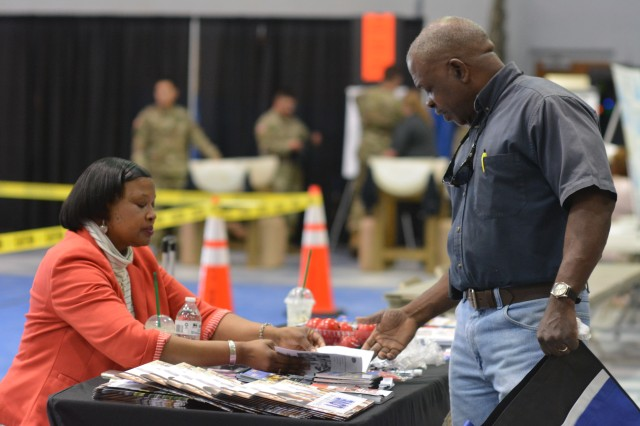 Community members perused through stands set up by subject matter experts who gave advice on risk mitigation, such as Army Community Service.