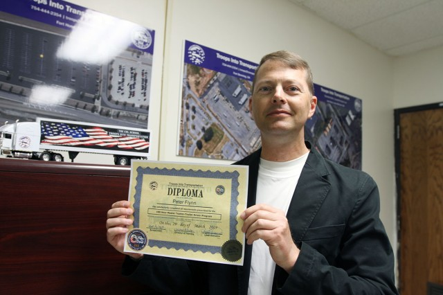 Retiring Staff Sgt. Peter Flynn, Reynolds Army Health Clinic Behavioral Health noncommissioned officer in charge, holds his graduation diploma from the Troops into Transportation's Master Tractor-Trailer Driver Program April 2, 2019, at the Soldier for Life Transition Complex here. He begins his new career May 1, with J.B. Hunt in Columbia, S.C.