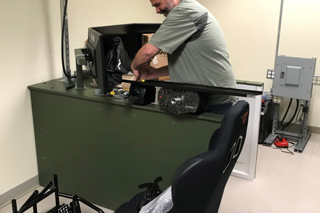 Jeff Loudin, U.S. Army Combat Capabilities Development Command Aviation & Missile Center Engineering Directorate Prototype Integration Facility government project lead, assembles a Stryker Virtual Collective Trainer at Fort Hood, Texas, on April 9.