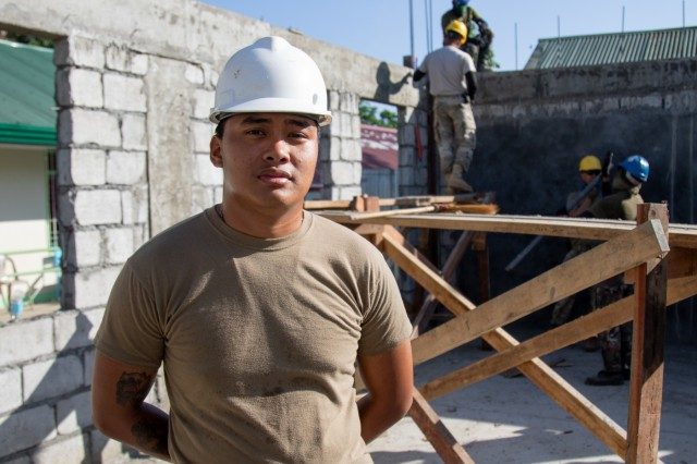 Pfc. Jason McCabe B. Dale, a plumber with the 561st Engineer Construction Company, 84th Engineer Battalion, pauses to take a portrait while working to construct a school at Orani, Bataan, Philippines, March 25, 2019.  Balikatan is a bilateral training exercise that strengthens cooperation in humanitarian and civic assistance activities and enables our service members to get to know each other and provide support to local communities. (U.S. Army photo by Sgt. Ariel J. Solomon)