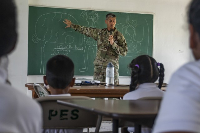 Col. Keith Lemmon, who serves as a pediatrician at Madigan Army Medical Center, Joint Base Lewis-McChord, teaches children the importance of resilience and mental health during a global health engagement at the Peleliu Elementary School, in Peleliu, Palau April 15, 2018, as part of Exercise Palau. The exercise is sponsored by U.S. Army Pacific and hosted by the nation of Palau, and strengthens the U.S. and Palau relationships, and contributes to a free and open Indo-Pacific. The exercise will run from April 13th - 19th 2019, and includes several security cooperation training events as well as community and animal health outreach services at several sites including Koror, Peleliu and Angaur. (U.S. Army Photo by Sgt. 1st Class Whitney C. Houston)