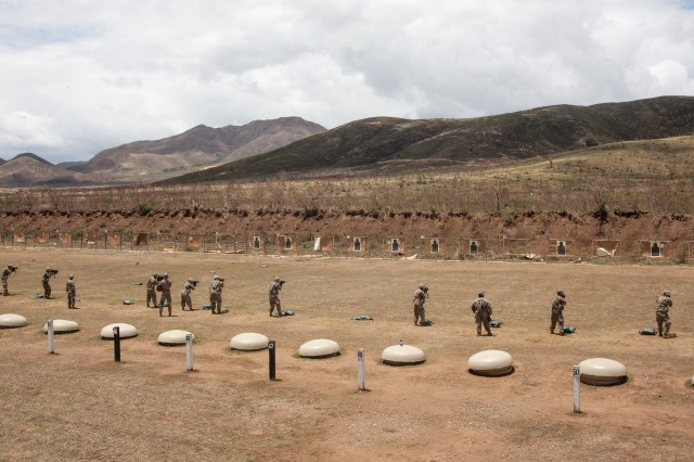 New York Army National Guard Soldiers assigned to Alpha Company, 1st Battalion, 69th Infantry Regiment conduct marksmanship training at Camp Santiago, Puerto Rico on Apr. 13, 2019. While in Puerto Rico the Soldiers honed their warfighting skills by practicing short-range marksmanship techniques.