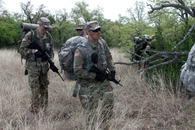 Wary ROTC cadets in 1st Platoon, a mixture of students from four participating Oklahoma universities, plot their ambush as part of spring FTX activities held on Fort Sill April 12-14, 2019