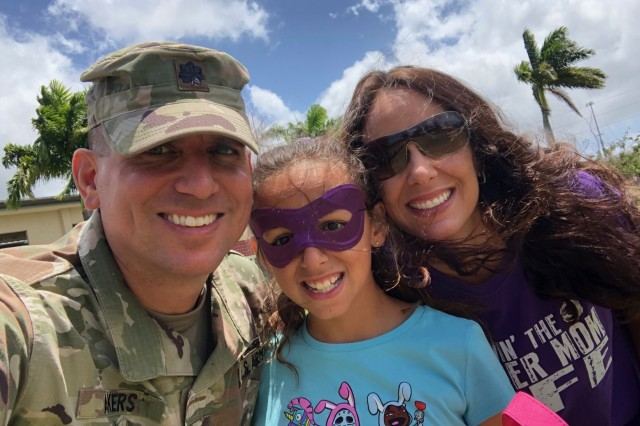 Lt. Col. Austin Akers, 9th Mission Support Command chief of operations, his wife and daughter pose for a picture during the Month of the Military Child-Family Day event April 13, at the Field of Heroes, Fort Shafter Flats, Hawaii. The event recognizes and honors the commitment and sacrifices military children make to our nation through the strength they provide our Soldiers and families. (Photo by Lt. Col. Austin Akers)