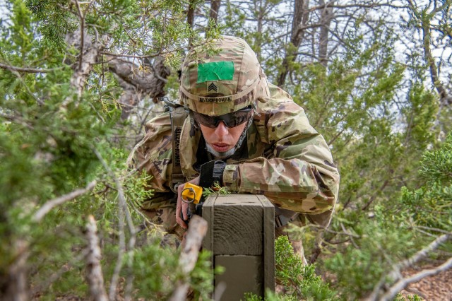 Sgt. Raymond Rivera-Roman a behavioral health specialist at Reynolds Army Health Clinic, negotiates a wall obstacle during the Expert Field Medical Badge competition held April 3, 2019, at Camp Eagle on Fort Sill.