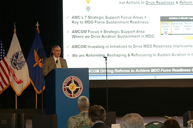 Bill Marriott, the U.S. Army Aviation and Missile Command's Executive Director, addresses hundreds of fellow aviators and senior leaders at the Army Aviation Association of America summit.