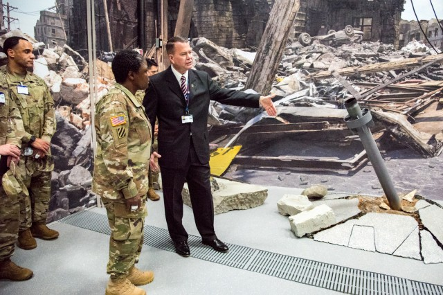 "CDTF Director Daniel Murray shows Maj. Gen. Donna Martin, Maneuver Support Center of Excellence and Fort Leonard Wood commanding general, one of the 11 new training, or ""target"" areas. The CDTF held a ribbon cutting ceremony Monday signifying the end of the $6 million, six-month redesign."