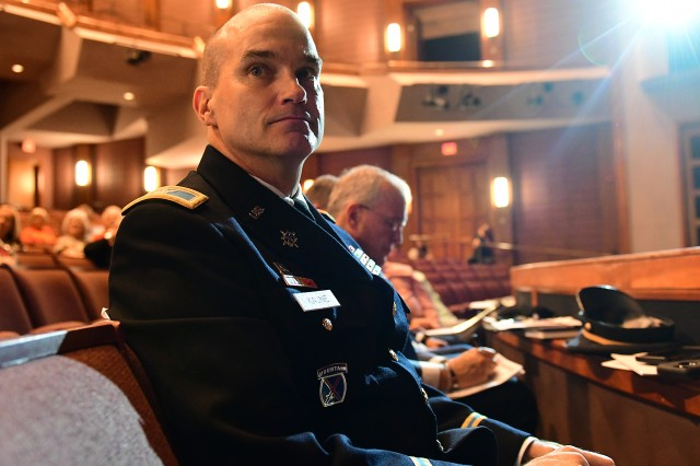 Col. Pat Kaune, Fort Knox Garrison commander, sits prepared to answer any questions asked of Maj. Gen. John Evans Jr. He and other panelists attended the April 17, 2019 town hall held at the Hardin County Schools Performing Arts Center.