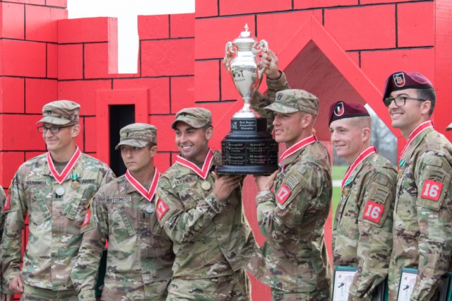 1st Lt. Terence Hughes and Capt. John Baer, Team 17 with 39th Bde. Engr. Bn., hold the first place trophy after being announced as the winners of this year's competition