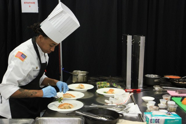 Spc. Khylissia Robertson, a culinary specialist, prepares Asian crusted salmon March 10 during the Joint Culinary Training Exercise's team nutrition competition at Maclaughlin Fitness Center, Fort Lee, Va. The 44th annual JCTE, administered by the Joint Culinary Center of Excellence, began March 9, and ended March 14. The exercise is the largest American Culinary Federation-sanctioned competition in North America and showcases the talents of more than 200 military chefs from around the world. The St. Louis, Mo.-native serves with 2nd Battalion, 327th Infantry Regiment, 1st Brigade Combat Team, 101st Airborne Division (Air Assault). (U.S. Army photo by Pfc. Lynnwood Thomas, 40th Public Affairs Detachment)