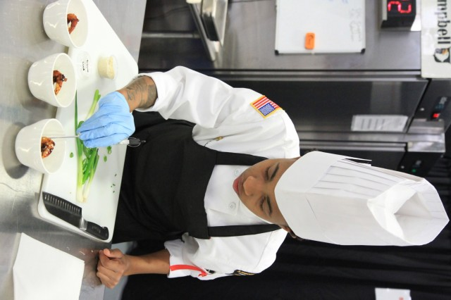 Spc. Khylissia Robertson, a culinary specialist, garnishes honey garlic shrimp March 10 during the Joint Culinary Training Exercise's team nutrition competition at Maclaughlin Fitness Center, Fort Lee, Va. The 44th annual JCTE, administered by the Joint Culinary Center of Excellence, began March 9, and ended March 14. The exercise is the largest American Culinary Federation-sanctioned competition in North America and showcases the talents of more than 200 military chefs from around the world. The St. Louis, Mo.-native serves with 2nd Battalion, 327th Infantry Regiment, 1st Brigade Combat Team, 101st Airborne Division (Air Assault). (U.S. Army photo by Pfc. Lynnwood Thomas, 40th Public Affairs Detachment)