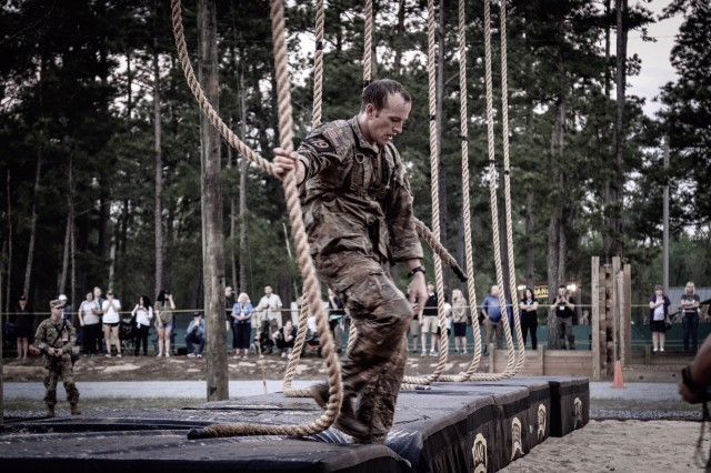 Capt. John Bergman and Capt. Michael Rose, of 3rd Brigade Combat Team, 101st Airborne Division (Air Assault), navigate obstacles during three grueling days at the U.S. Army Best Ranger Competition, Apr. 10-12 at Fort Benning, Georgia. The team ultimately finished in first place out of 55 teams Army-wide, their second victory as a team and Rose's third as a competitor, a new Army record.