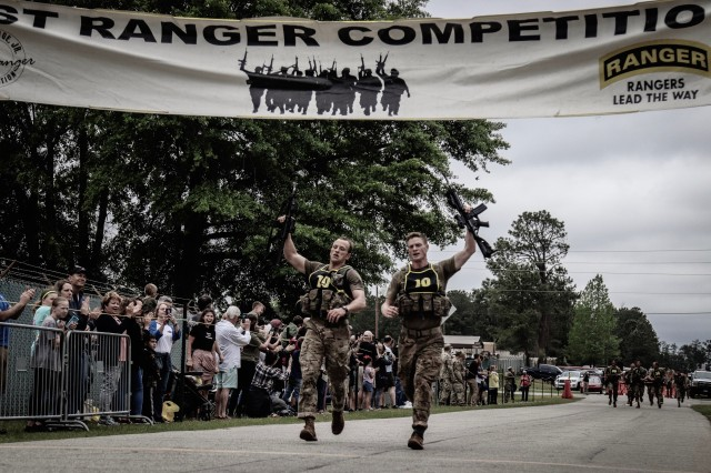 Capt. John Bergman and Capt. Michael Rose, of 3rd Brigade Combat Team, 101st Airborne Division (Air Assault) cross the finish line after three grueling days at the U.S. Army Best Ranger Competition, Apr. 12 at Fort Benning, Georgia. The team ultimately finished in first place out of 55 teams Army-wide, their second victory as a team and Rose's third as a competitor, a new Army record.