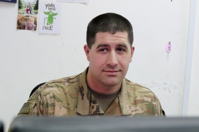 Capt. Patrick Cooper, 529th Support Battalion, works in his office at Camp Taji, Iraq, March 9, 2019.