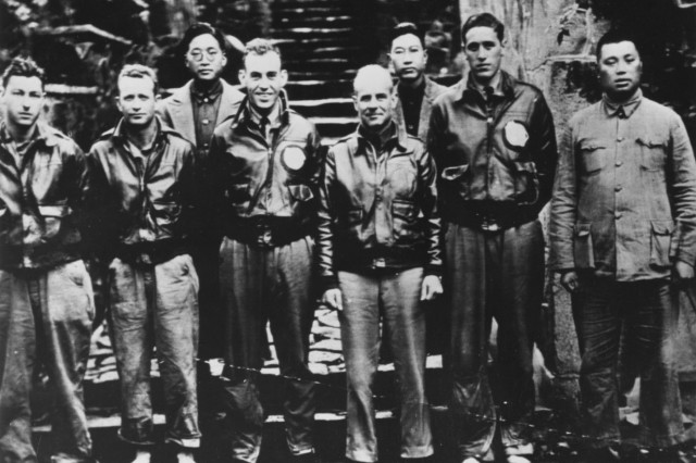 Lt. Col. James H. (Jimmy) Doolittle, center, with members of his crew and Chinese officials following their bailout near Quzhou, China.  On 18 April 1942, Airmen of the U.S. Army Air Corps, led by Doolittle, carried the Battle of the Pacific to the heart of the Japanese empire with a surprising and daring raid on military targets at Tokyo, Yokohama, Yokosuka, Nagoya, and Kobe. This heroic attack against these major cities was the result of coordination between the U.S. Army Air Corps and the U.S. Navy, which carried the 16 North American B-25 medium bombers aboard the carrier USS Hornet to within take-off distance of the Japanese Islands.
