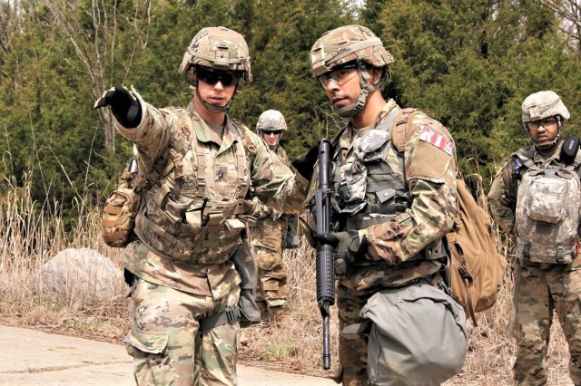 An Army Reserve 100th Training Division Soldier gives guidance to a competitor on reacting to indirect contact during the 2019 Combined Best Warrior Competition at Fort Knox, Kentucky, April 7-12. The 80th Training Command, 84th Training Command, 377th Theater Sustainment Command, 88th Readiness Division, 81st Readiness Division, 99th Readiness Division, Army Reserve Aviation Command, and AR Careers Division joined their resources in creating this year's competition.