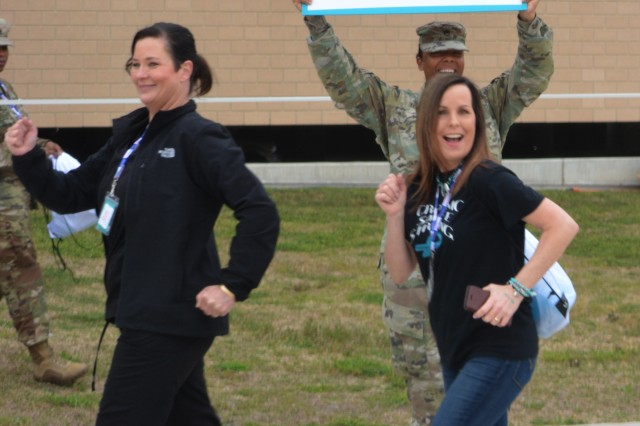 """(From left) Carl R. Darnall Army Medical Center employees,  Sheilah Priori and Sophia Wilson, step up their strides during the hospital's 71-hour relay run/walk to demonstrate support for sexual assault survivors. Nearly 1,500 people from ages 3 weeks to 75 years came out to show their support during the event that spanned four days. The 1st Cavalry Division's cannon boom marked the start of the 71-hour event at 10 a.m. Friday, April 5, and ended when the last participant crossed the finish line at 9 a.m. Monday, April 8. The run represents the 71 sexual assault survivors, who in 2018, sought help through CRDAMC's Emergency Department and its Sexual Assault Medical Forensic Exam Program (SAMFE). Preceding the ceremony was a symbolic trot around the designated track from 1st Cavalry Division's horse detachment. The purpose of the annual Sexual Assault Awareness Month is to raise public awareness about sexual violence. This year's theme is """"Making Strides Against Assault.""""Launched in 2014 as part of the National Defense Act that mandated assignment of forensically trained sexual assault personnel to military units, the SAMFE program provides 24-hour services, seven days a week to TRICARE beneficiaries 14 years and older, as well as non-beneficiary victims of on-post assaults. The forensic response team also provides support to those survivors from trauma to trial."""
