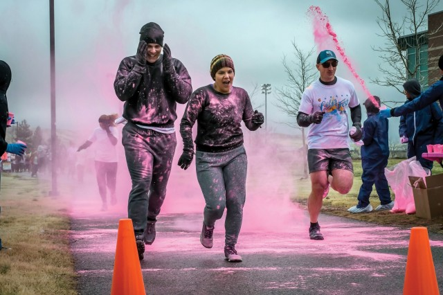 FORT CARSON, Colo. - Runners get hit with the first colored powder while participating in the Color Run April 13, 2019, at the Carson Color Fest and Creative Arts Festival at the Iron Horse Sports and Fitness Center. (Photo by Amber Martin)