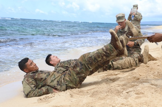 Eight Soldiers and eight NCOs completed an exercise circuit on Mokuleia Beach, Hawaii, during their final event, on April 18, 2019, for RHC-P's 2019 Best Warrior Competition.