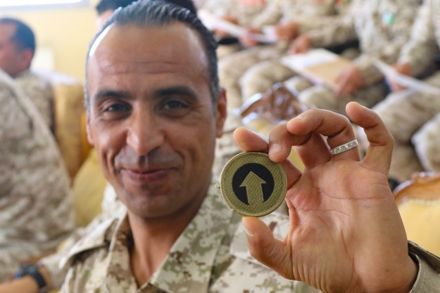 A Jordanian Soldier holds up the 1st Theater Sustainment Command patch after it was presented to him during the United States Army and Jordan Armed Forces subject matter expert noncommissioned officer exchange in Amman, Jordan, April 6-10, 2019. Topics included the enlisted force structure, promotions, professional military education, performance feedback, evaluation processes, and career development for both armies. The U.S. and Jordan remain committed to a strong bilateral relationship built on common interests and mutual respect.