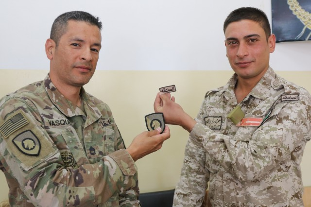 U.S. Army Sgt. 1st Class Mauricio Vasquez and a Jordanian Soldier swap patches after the conclusion of the United States Army and Jordan Armed Forces subject matter expert noncommissioned officer exchange in Amman, Jordan, April 6-10, 2019. Topics included the enlisted force structure, promotions, professional military education, performance feedback, evaluation processes, and career development for both armies. The U.S. and Jordan remain committed to a strong bilateral relationship built on common interests and mutual respect.