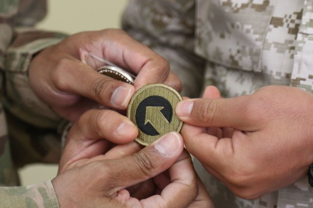 A Jordanian Soldier is presented with a 1st Theater Sustainment Command patch following the the United States Army and Jordan Armed Forces noncommissioned officer subject matter expert exchange in Amman, Jordan, April 6-10, 2019. Topics included the enlisted force structure, promotions, professional military education, performance feedback, evaluation processes, and career development for both armies. The U.S. and Jordan remain committed to a strong bilateral relationship built on common interests and mutual respect.