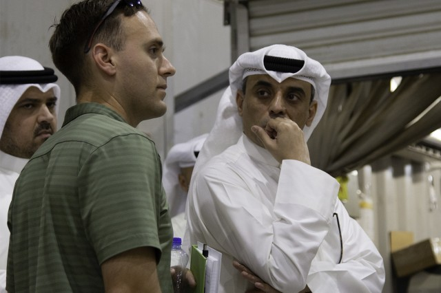 A Soldier from the U.S. Army Criminal Investigation Division asks a question regarding operations at the Joint Military Mail Terminal at Camp Arifjan, Kuwait, March 7, 2019. (U.S. Army Reserve photo by Capt. Jerry Duong)