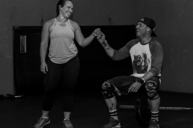U.S. Army Sgt. 1st Class Josiah Noble, right, a paratrooper assigned to the 2nd Brigade Combat Team, 82nd Airborne Division, and his wife Kelci, fist bump after completing their work out of the day at CrossFit Raeford in Fayetteville, NC, April 16, 2019. The workout enthusiasts compete in several CrossFit events both locally and regionally each year, as well as compete against other through their gym's online leaderboard each day.