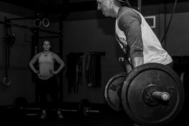 U.S. Army Sgt. 1st Class Josiah Noble, right, a paratrooper assigned to the 2nd Brigade Combat Team, 82nd Airborne Division, finishes his last set of the Hokie workout with his wife Kelci at CrossFit Raeford in Fayetteville, NC, April 16, 2019. The Hokie commemorated victims of the Virginia Tech shooting on April 16, 2007, that took away 32 innocent lives. The seven-round-workout consisted of four squat, clean and jerks; 16 deadlifts; and 32 double-unders.