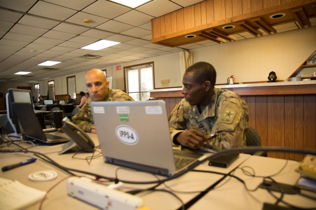 "Chief Warrant Officer 2 Lionel Blair, Systems Information Branch Chief for the VAARNG and Sgt. 1st Class Cliff Klaye, Senior Financial Manager discuss the Integrated Personnel and Pay System-Army during a senior leader engagement at Fort Pickett, Virginia April 8-12. Senior leaders from the IPPS-A team went to Fort Pickett to see how the Virginia Army National Guard is progressing with IPPS-A. The program went live for the VAARNG on April 5.""This system is more robust than SIDPERS,"" said Blair. ""SIDPERS was binary, so only select people had access. Now, we've got 300 HR professionals in the system, plus commanders, 1st Sergeants and Sergeant Majors. So, a lot of people are trying to get their footing and figure out their role in the system."""