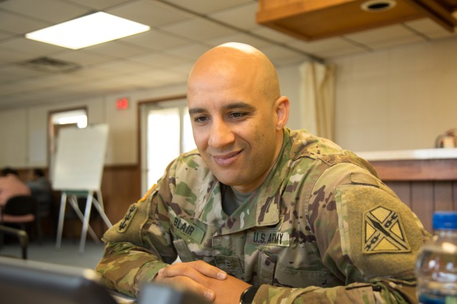 "Chief Warrant Officer 2 Lionel Blair, Systems Information Branch Chief for the VAARNG smiles during a senior leader engagement at Fort Pickett, Virginia at the progress he and the Virginia Army National Guard are making with the Integrated Personnel and Pay System-Army. IPPS-A went live for the VAARNG on April 5, and the early returns are satisfying for Blair. The VAARNG spent two years preparing to implement IPPS-A.""Getting to an end state of something we've been working on and seeing benefits is very satisfying,"" said Blair. ""Now, we're shifting gears to training to make sure we're training the field users of the system. It's nice to be at this point."""