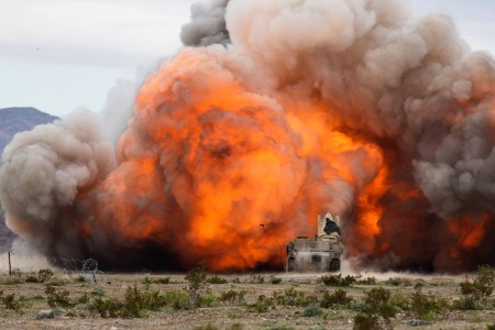 Soldiers from the 2nd Armored Brigade Combat Team, 1st Infantry Division blasts through a Combined Arms Breach at Fort Irwin National Training Center, Calif., March 20, 2019.
