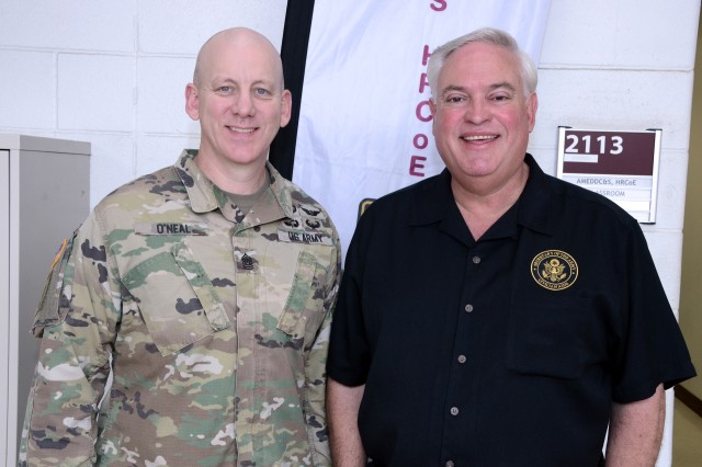 """(Left) CSM William """"Buck"""" O'Neal, Health Readiness Center of Excellence Command Sergeant Major pictured with (Right) Mr. Mario Guerra, Civilian Aide to the Secretary of the Army, during a visit of over three dozen high school educators and key influencers from the Los Angeles area to JBSA-Fort Sam Houston to learn about Army Medicine as part of an annual U.S. Army LA Recruiting Battalion initiative."""
