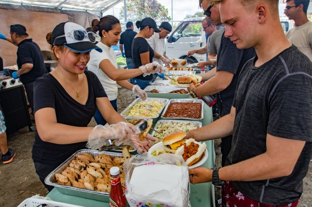 Joanne Vocal (left), a Palaun citizen, serves food after the Palau Exercise closing ceremony barbeque to Sgt. Ireland Kelly, who serves with 5th Battalion, 20th Infantry Regiment, 1-2 Stryker Brigade Combat Team, 7th Infantry Division, at Meyuns Softball Field in Koror, Palau, April 19, 2019. Exercise Palau is part of Pacific Pathways, an annual U.S. Army Pacific (USARPAC) operation, demonstrating the U.S. Army's commitment to the Palau nation, security cooperation for a free and open Indo-Pacific.