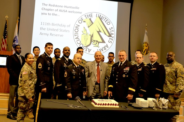 Army Reserve Soldiers, including retired Maj. Gen. Michael Diamond; then-Brig. Gen. Bob Harter; and Sgt. 1st Class Liang Zhou, 4th Battalion, 108th Regiment (Chemical), cut the cake during the Army Reserve's 111th Birthday Breakfast at the Jackson Center in Huntsville, April 17. Harter was promoted to major general April 18.