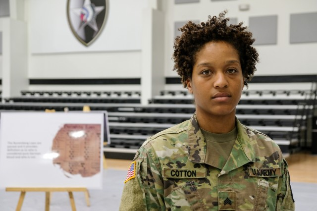 Sgt. Krisceda Cotton, native of Gaston, S.C., signal support systems specialist and equal opportunity leader, assigned to Headquarters and Headquarters Battery, 1st Battalion, 38th Field Artillery Regiment, 210th Field Artillery Brigade, stands for a photo after the end of the Holocaust Remembrance, April 12 at Camp Casey, Republic of Korea. Cotton planned the remembrance, which featured an interactive display of key facts and photographs of the Holocaust. (U.S. Army photo by Capt. Daniel Parker)